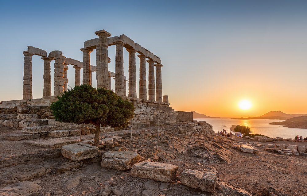The Ancient Temple Of Poseidon During A Summer Sunset