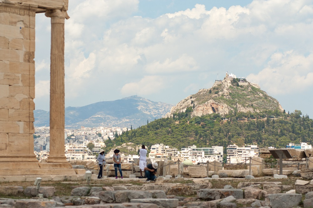 Tourists Near The Temple Of Erechteion With View On Athens